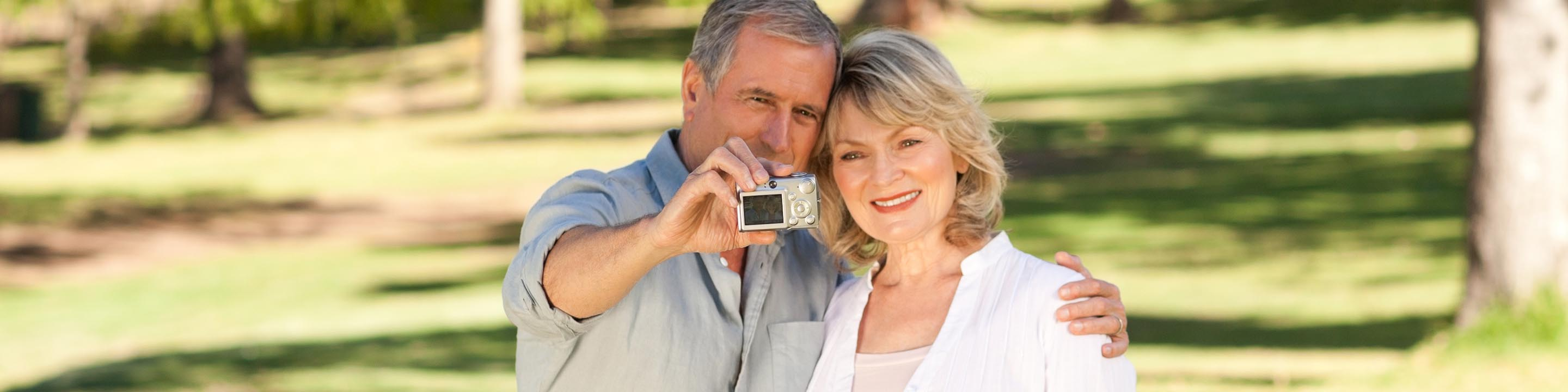 Image of husband and wife taking a picture.