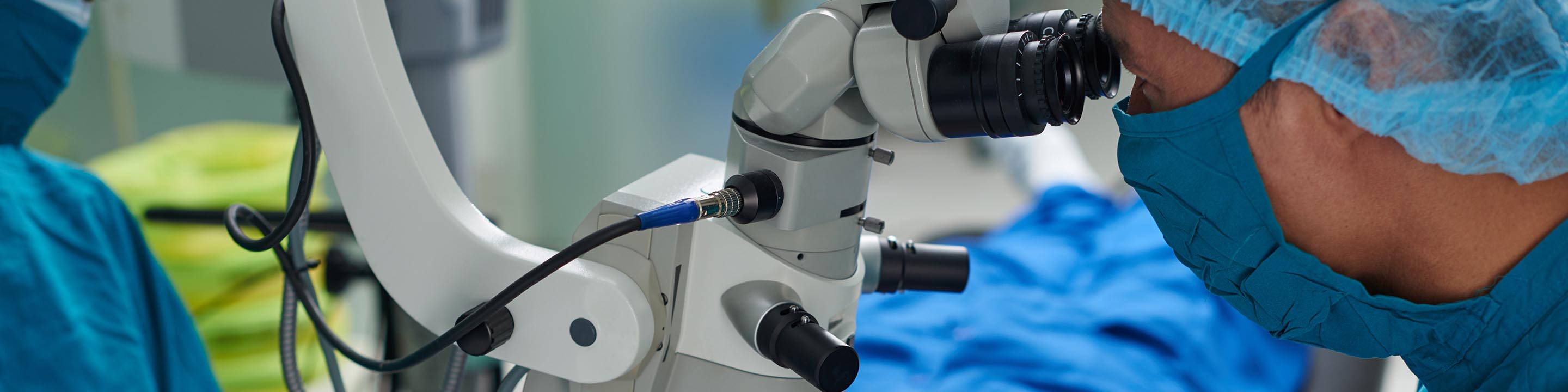 Image of doctor using laser equipment for eye surgery.