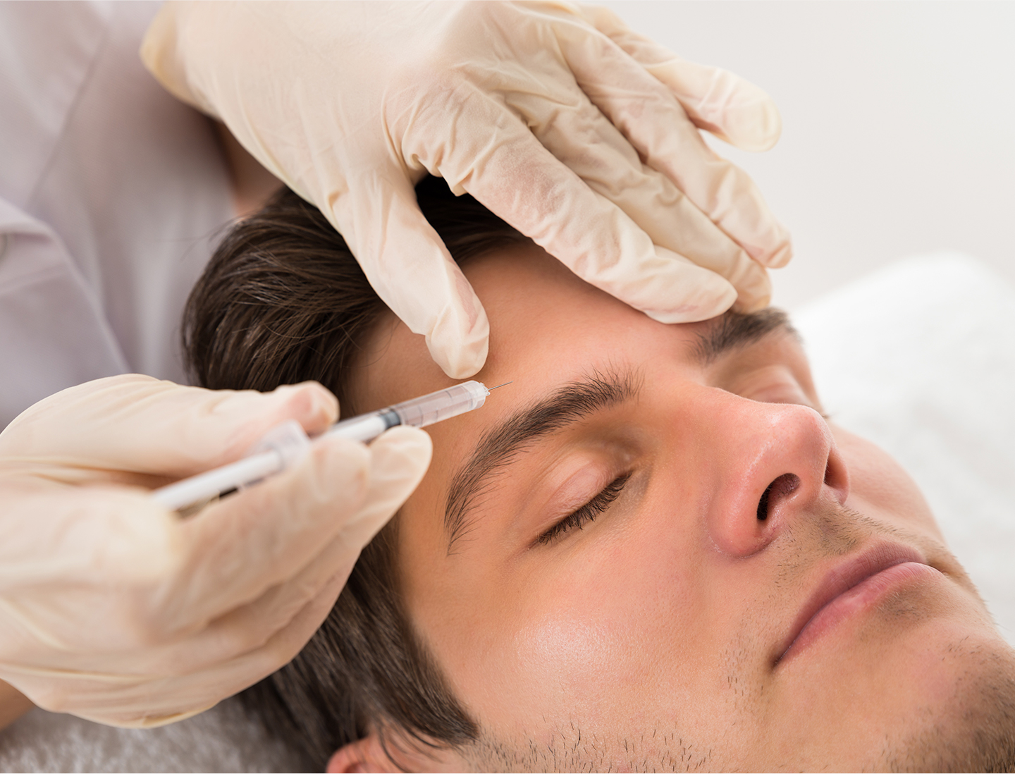 Man having Botox injection to forehead.